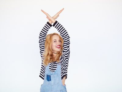 Blonde hipster girl showing stop gesture
