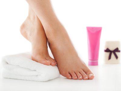 Woman is enjoying foot treatment.