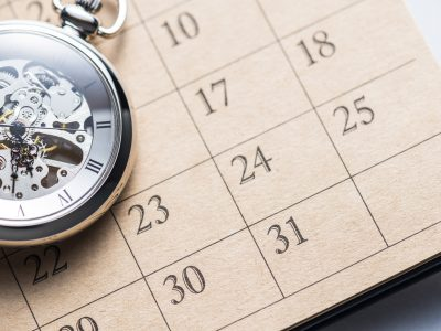 Pocket watch on calendar.