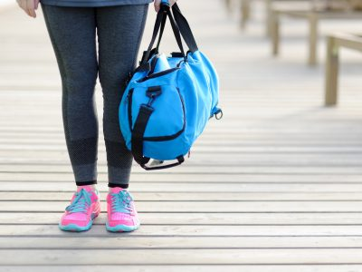 Women with a blue sports bag. Before training