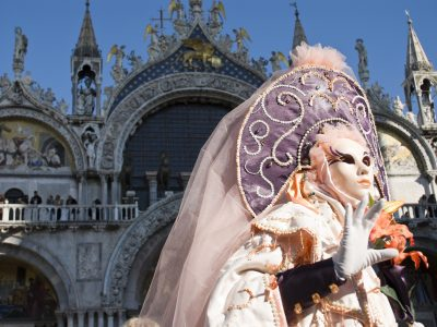 Traditionally dressed Venice carnival female performer in Piazza San Marco, Italy