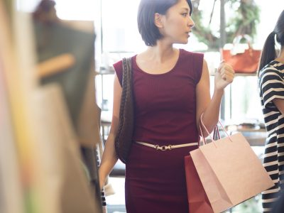 Women are enjoying shopping at clothing store