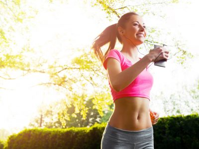 Fit young woman running outdoors, healthy lifestyle