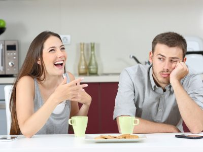 Bored husband hearing his wife talking