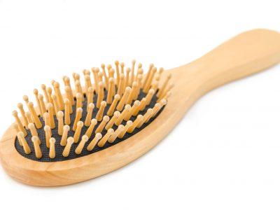 Wooden hair brush.