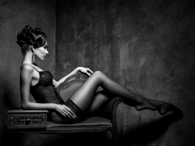 Woman in lingerie and stockings in a vintage interior