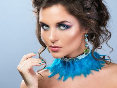 Gorgeous woman with beautiful earrings and necklace