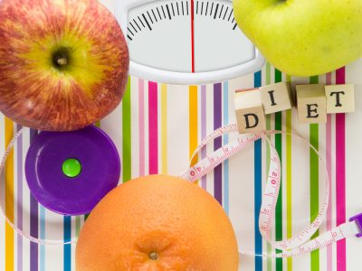 Bathroom scale with fruits and diet text on dial with lines no numbers